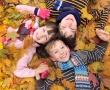 stock-photo-11282787-children-in-autumn-leaves